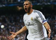 MADRID, SPAIN - APRIL 23:  Karim Benzema of Real Madrid celebrates scoring the opening goal during the UEFA Champions League semi-final first leg match between Real Madrid and FC Bayern Muenchen at the Estadio Santiago Bernabeu on April 23, 2014 in Madrid, Spain.  (Photo by Martin Rose/Bongarts/Getty Images)