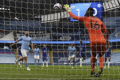 Chelsea's goalkeeper Edouard Mendy saves a penalty shot by Manchester City's Sergio Aguero, left, during the English Premier League soccer match between Manchester City and Chelsea at the Etihad Stadium in Manchester, Saturday, May 8, 2021.(Shaun Botterill /Pool via AP)