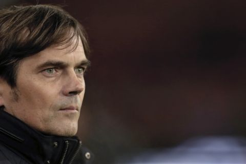 PSV's head coach Phillip Cocu watches his players as they line up for the Group E Europa League match between PSV Eindhoven and Dinamo Moscow at Philips stadium, in Eindhoven, Netherlands, Thursday, Dec. 11, 2014. (AP Photo/Peter Dejong)
