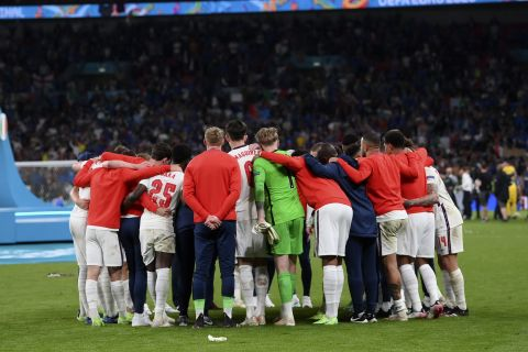 English players react after the Euro 2020 soccer final match between England and Italy at Wembley stadium in London, Sunday, July 11, 2021. (Laurence Griffiths/Pool via AP)