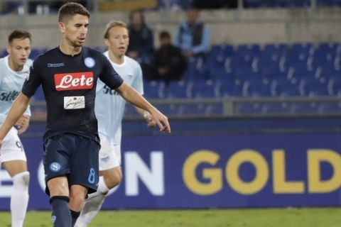 FILE - In this Sept. 20, 2017 file photo, Napoli's Jorginho scores on a penalty kick, during a Serie A soccer match between Lazio and Napoli, at the Rome Olympic stadium. Simone Zaza and Alessandro Florenzi are back in the Italy squad for the first time in a year, and there was also a surprise call-up for Jorghino for the World Cup playoff against Sweden. (AP Photo/Alessandra Tarantino)