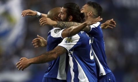 Porto's Sergio Oliveira, center, celebrates after scoring the opening goal during the Portuguese league soccer match between FC Porto and Feirense at the Dragao stadium in Porto, Portugal, Sunday, May 6, 2018. Porto clinched the league title Saturday night, two rounds before the end, when Benfica and Sporting CP tied 0-0 in their Lisbon derby. (AP Photo/Luis Vieira)