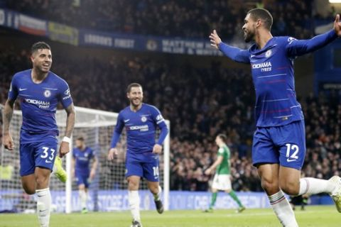 Chelsea's Ruben Loftus-Cheek, right, celebrates with teammates Eden Hazard, center, and Emerson, left, after scoring his sides third goal during the English Premier League soccer match between Chelsea and Brighton & Hove Albion at Stamford Bridge stadium in London, Wednesday, April 3, 2019. (AP Photo/Frank Augstein)
