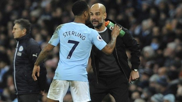 Manchester City's Raheem Sterling, left, and Manchester City manager Josep Guardiola during the English Premier League soccer match between Manchester City and Leicester City at the Etihad Stadium in Manchester, England, Saturday, Feb. 10, 2018. (AP Photo/Rui Vieira)