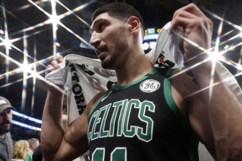 In this photo taken with a star filter, Boston Celtics' Enes Kanter leaves the court after their win in an NBA basketball game against the New Orleans Pelicans Saturday, Jan. 11, 2020, in Boston. (AP Photo/Winslow Townson)