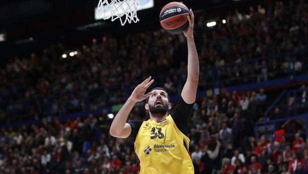 Barcelona's Nikola Mirotic scores a basket during the Euro League basketball match between Olimpia Milan and FC Barcelona Lassa, in Milan, Italy, Friday, Nov. 1, 2019. (AP Photo/Antonio Calanni)