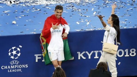 Real Madrid's Cristiano Ronaldo, left, and his girlfriend Georgina Rodriguez celebrate after the Champions League Final soccer match between Real Madrid and Liverpool at the Olimpiyskiy Stadium in Kiev, Ukraine, Saturday, May 26, 2018. Madrid defeated Liverpool by 3-1. (AP Photo/Darko Vojinovic)
