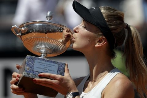 Ukraine's Elina Svitolina kisses the trophy after winning her final match against Simona Halep at the Italian Open tennis tournament, in Rome, Sunday, May 20, 2018. Svitolina won 6-0, 6-4. (AP Photo/Gregorio Borgia)