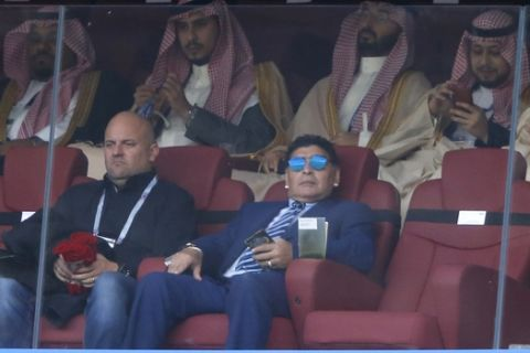 Argentina's former soccer star Diego Armando Maradona, with sunglasses, looks on ahead of the group A match between Russia and Saudi Arabia which opens the 2018 soccer World Cup at the Luzhniki stadium in Moscow, Russia, Thursday, June 14, 2018. (AP Photo/Hassan Ammar)