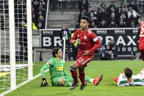 Bayern's Serge Gnabry, center, just scored his side's 4th goal during the German Bundesliga soccer match between Borussia Moenchengladbach and FC Bayern Munich in Moenchengladbach, Germany, Saturday, March 2, 2019. (AP Photo/Martin Meissner)