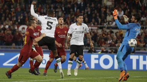 Liverpool's Georginio Wijnaldum scores his side's second goal during the Champions League semifinal second leg soccer match between Roma and Liverpool at the Olympic Stadium in Rome, Wednesday, May 2, 2018. (AP Photo/Andrew Medichini)