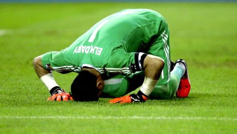 Egypt goalkeeper Essam El Hadary bows on the pitch after stopping a penalty shot from Burkina Faso goalkeeper Kouakou Herve Koffi at the end of the African Cup of Nations semifinal soccer match between Burkina Faso and Egypt at the Stade de l'Amitie, in Libreville, Gabon, Wednesday, Feb. 1, 2017. Egypt defeated Burkins Faso 4-3 in a penalty shoot out after the game ended tied 1-1. (AP Photo/Sunday Alamba)