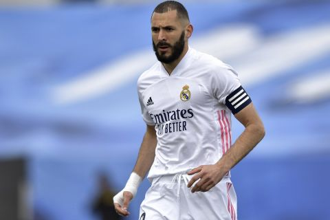 Real Madrid's Karim Benzema moves on the pitch during the Spanish La Liga last round soccer match between Real Madrid and Villarreal at the Alfredo Di Stefano stadium in Madrid, Saturday, May 22, 2021. (AP Photo/Pablo Morano)