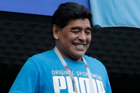 Argentina former soccer star Diego Maradona smiles as the fans take photographs ahead of the group D match between Argentina and Nigeria, at the 2018 soccer World Cup in the St. Petersburg Stadium in St. Petersburg, Russia, Tuesday, June 26, 2018. (AP Photo/Petr David Josek)