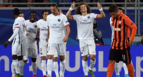 Paris Saint-Germain's Brazilian defender David Luiz (2nd R) celebrates after scoring a goal during the UEFA Champions League group A football match between Shakhtar Donetsk and Paris Saint-Germain at the Arena Lviv, in the Ukrainian city of Lviv, on September 30, 2015. AFP PHOTO / PASCAL GUYOT        (Photo credit should read PASCAL GUYOT/AFP/Getty Images)