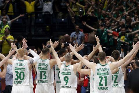 Zalgiris players raise their arms in celebration after winning at Final Four Euroleague third place basketball match between CSKA Moscow and Zalgiris Kaunas in Belgrade, Serbia, Sunday, May 20, 2018. (AP Photo/Darko Vojinovic)