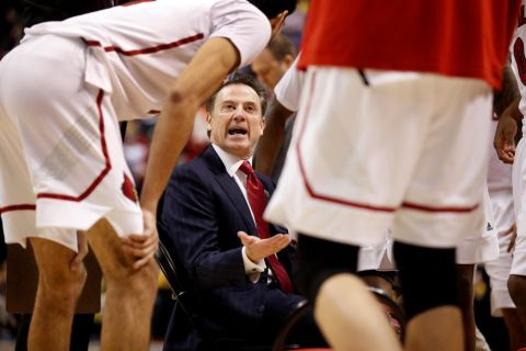 Louisville head coach Rick Pitino talks to his team during timeout in the first half of a second-round game against Michigan in the men's NCAA college basketball tournament Sunday, March 19, 2017, in Indianapolis. (AP Photo/Jeff Roberson)