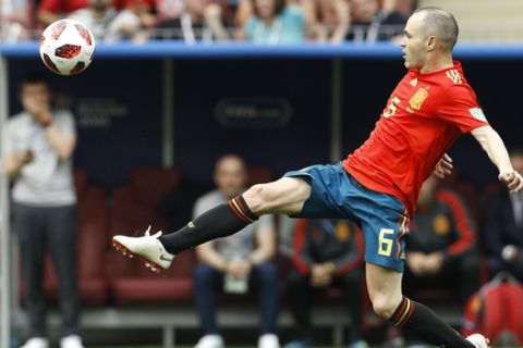 Spain's Andres Iniesta controls the ball during the round of 16 match between Spain and Russia at the 2018 soccer World Cup at the Luzhniki Stadium in Moscow, Russia, Sunday, July 1, 2018. (AP Photo/Victor R. Caivano)