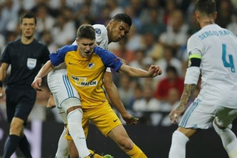 Real Madrid's Casemiro, rear, battles for the ball with APOEL Nicosia's Roland Sallai during a Champions League group H soccer match between Real Madrid and Apoel Nicosia at the Santiago Bernabeu stadium in Madrid, Spain, Wednesday, Sept. 13, 2017. (AP Photo/Paul White)