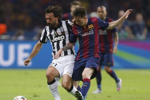 Juventus' Andrea Pirlo, left, is challenged by Barcelona's Lionel Messi during the Champions League final soccer match between Juventus Turin and FC Barcelona at the Olympic stadium in Berlin Saturday, June 6, 2015. (AP Photo/Frank Augstein)