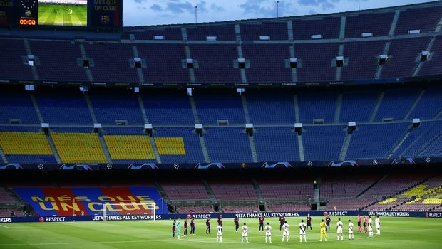 Players observe a moments silence before the Champions League round of 16, second leg soccer match between Barcelona and Napoli at the Camp Nou Stadium in Barcelona, Spain, Saturday, Aug. 8, 2020. (AP Photo/Joan Monfort)
