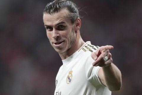 Real Madrid's Gareth Bale gestures during the Spanish La Liga soccer match between Atletico Madrid and Real Madrid at the Wanda Metropolitano stadium in Madrid, Saturday, Sept. 28, 2019. (AP Photo/Bernat Armangue)
