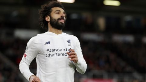 Liverpool's Mohamed Salah, celebrates after scoring his side's third goal during the English Premier League soccer match between Bournemouth and Liverpool at the Vitality stadium in Bournemouth, England, Saturday, Dec. 7, 2019. (AP Photo/Alastair Grant)