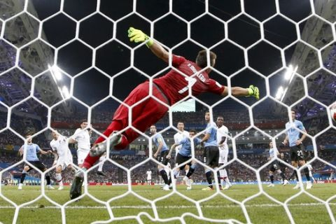 Portugal's Pepe scores his side's opening goal past Uruguay goalkeeper Fernando Muslera during the round of 16 match between Uruguay and Portugal at the 2018 soccer World Cup at the Fisht Stadium in Sochi, Russia, Saturday, June 30, 2018. (AP Photo/Andrew Medichini)