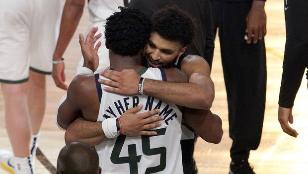 Utah Jazz's Donovan Mitchell (45) and Denver Nuggets' Jamal Murray, center rear, greet each other after their NBA first round playoff basketball game, Tuesday, Sept. 1,2020, in Lake Buena Vista, Fla. The Nuggets won 80-78. (AP Photo/Mark J. Terrill)