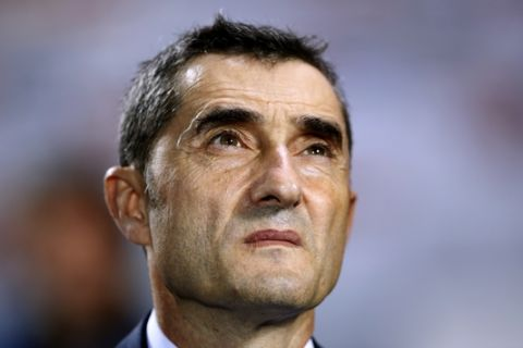 FC Barcelona's coach Ernesto Valverde looks on ahead of the Spanish La Liga soccer match between Leganes and FC Barcelona at the Butarque stadium in Leganes, Spain, Wednesday, Sept. 26, 2018. (AP Photo/Manu Fernandez)