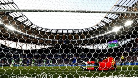 Iceland's Gylfi Sigurdsson kicks the ball, top left, over the bar to miss a penalty, during the group D match between Nigeria and Iceland at the 2018 soccer World Cup in the Volgograd Arena in Volgograd, Russia, Friday, June 22, 2018. (AP Photo/Andrew Medichini)