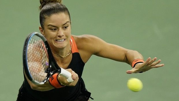 Maria Sakkari, of Greece, returns a shot to Serena Williams during the third round at the Western & Southern Open tennis tournament Tuesday, Aug. 25, 2020, in New York. (AP Photo/Frank Franklin II)