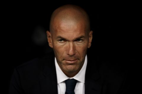 Real Madrid coach Zinedine Zidane reacts from the bench during a La Liga soccer match between Real Madrid and Stade de Reims at the Santiago Bernabeu stadium in Madrid, Spain, Tuesday, Aug. 16, 2016. (AP Photo/Daniel Ochoa de Olza)