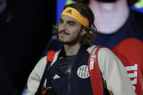 Stefanos Tsitsipas of Greece walks onto court ahead of his match against Austria's Dominic Thiem in their ATP World Finals singles final tennis match at the O2 arena in London, Sunday, Nov. 17, 2019. (AP Photo/Kirsty Wigglesworth)