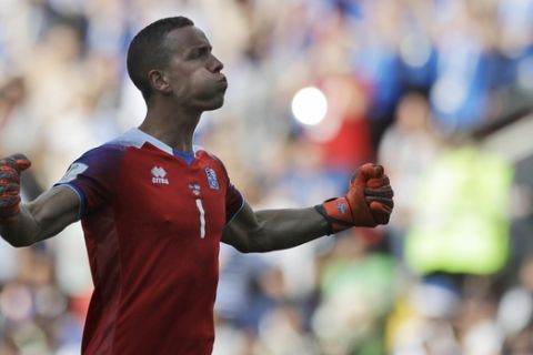 Iceland goalkeeper Hannes Halldorsson celebrates after his side scored their first goal during the group D match between Argentina and Iceland at the 2018 soccer World Cup in the Spartak Stadium in Moscow, Russia, Saturday, June 16, 2018. (AP Photo/Matthias Schrader)