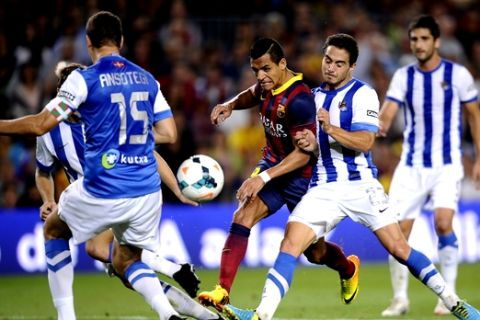 FC Barcelona's Alexis Sanchez, from Chile, third right, duels for the ball against Real Sociedad's Javi Ros, second right, during a Spanish La Liga soccer match at the Camp Nou stadium in Barcelona, Spain, Tuesday, Sept. 24, 2013. (AP Photo/Manu Fernandez)