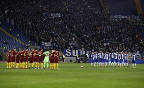 Roma and Porto players hold a one-minute silence to honor Emiliano Sala, who died in an airplane crash in the English Channel last month, before a Champions League round of 16 first leg soccer match between Roma and Porto, at Rome's Olympic Stadium, Tuesday, Feb. 12, 2019. (AP Photo/Andrew Medichini)