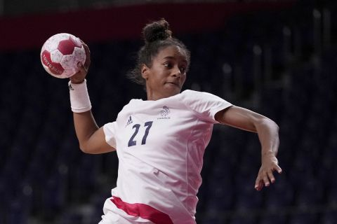France's Estelle Nze Minko tries to score during the women's semifinal handball match between France and Sweden at the 2020 Summer Olympics, Friday, Aug. 6, 2021, in Tokyo, Japan. (AP Photo/Pavel Golovkin)