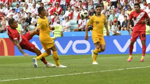 Peru's Paolo Guerrero, left, scores his side's second goal during the group C match between Australia and Peru, at the 2018 soccer World Cup in the Fisht Stadium in Sochi, Russia, Tuesday, June 26, 2018. (AP Photo/Martin Meissner)