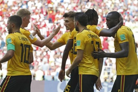 Belgium players celebrate after teammate Romelu Lukaku, right, scored their team's third goal during the group G match between Belgium and Tunisia at the 2018 soccer World Cup in the Spartak Stadium in Moscow, Russia, Saturday, June 23, 2018. (AP Photo/Antonio Calanni)