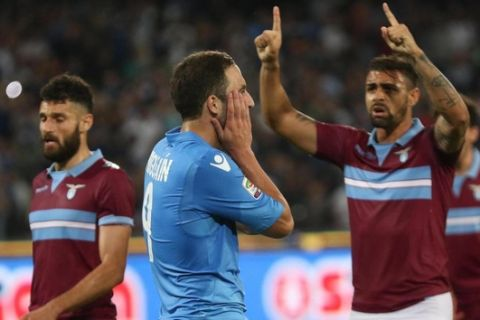 The disappointment of Napoli's forward Gonzalo Higuain after the mistake on the penalty kick during the Italian Serie A soccer match between SSC Napoli and SS Lazio at San Paolo Stadium in Naples, 31 May 2015. ANSA/ CESARE ABBATE