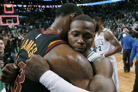Cleveland Cavaliers forward LeBron James, left, embraces Boston Celtics guard Terry Rozier after the Cavaliers' 87-79 victory in Game 7 of the NBA basketball Eastern Conference finals, Sunday, May 27, 2018, in Boston. (AP Photo/Elise Amendola)