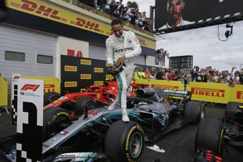 Mercedes driver Lewis Hamilton of Britain steps from his car after winning the French Formula One Grand Prix at the Paul Ricard racetrack, in Le Castellet, southern France, Sunday, June 24, 2018. (AP Photo/Claude Paris)