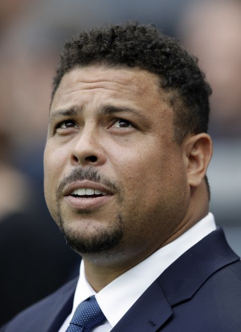Brazilian soccer legend Ronaldo watches the group A match between Russia and Saudi Arabia which opens the 2018 soccer World Cup at the Luzhniki stadium in Moscow, Russia, Thursday, June 14, 2018. (AP Photo/Matthias Schrader)