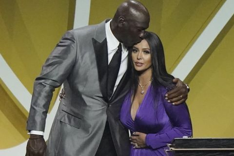 Michael Jordan, let, kisses head of Vanessa Bryant, widow of Kobe Bryant, after Bryant, represented by his wife, was enshrined with the 2020 Basketball Hall of Fame class Saturday, May 15, 2021, in Uncasville, Conn.