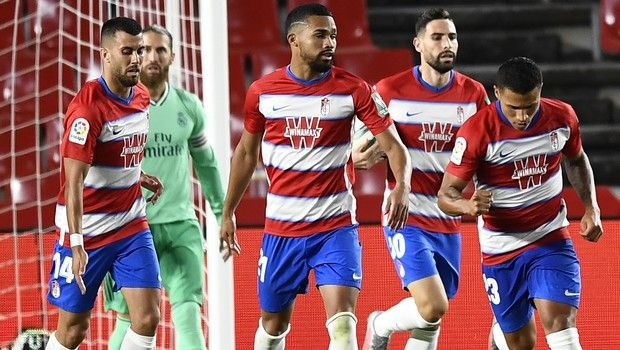 Granada's Darwin Machis, right, celebrates after scoring his side's first goal during the Spanish La Liga soccer match between Granada and Real Madrid at the Los Carmenes stadium in Granada, Spain, Monday, July 13, 2020. (AP Photo/Jose Breton)