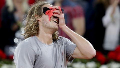 Stefanos Tsitsipas of Greece reacts after winning Rafael Nadal of Spain during the Madrid Open tennis men's semi-final match in Madrid, Spain, Saturday, May 11, 2019. (AP Photo/Bernat Armangue)
