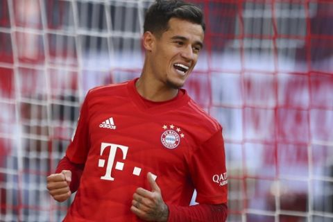 Bayern's Philippe Coutinho celebrates after scoring during the German Bundesliga soccer match between FC Bayern Munich and 1. FC Cologne in Munich, Germany, Saturday, Sept. 21, 2019. (AP Photo/Matthias Schrader)