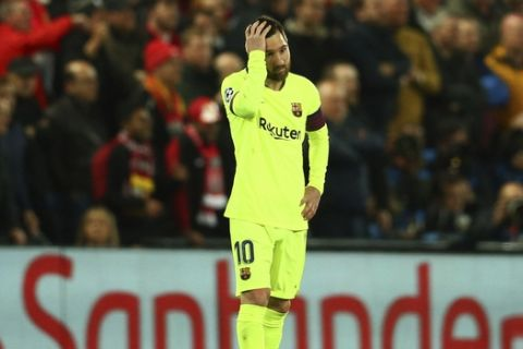Barcelona's Lionel Messi reacts as Liverpool's Divock Origi celebrates scoring his side's 4th goal during the Champions League semifinal, second leg, soccer match between Liverpool and FC Barcelona at the Anfield stadium in Liverpool, England, Tuesday, May 7, 2019. (AP Photo/Dave Thompson)