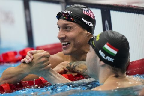 Caeleb Dressel, of United States, celebrates after wining the gold medal in the men's 100-meter butterfly final at the 2020 Summer Olympics, Saturday, July 31, 2021, in Tokyo, Japan. (AP Photo/David Goldman)